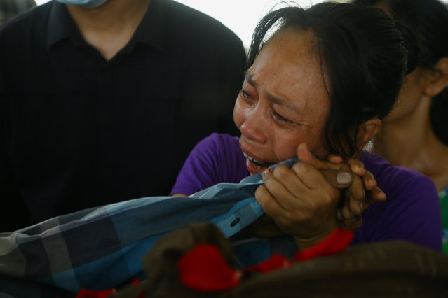A family member mourns over the death of Aung Myo Thant as they gather at his funeral in Yangon, Myanmar, Tuesday, March 30, 2021. Family members said Aung Myo Thant was killed Monday during a clash with security forces at a protest against the military's coup that ousted the government of Aung San Suu Kyi on Feb. 1. (Photo by AP Photo/Stringer)