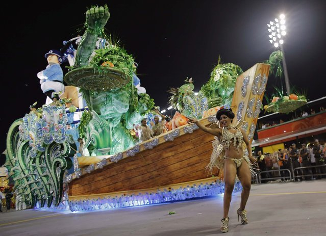 A reveller from the Aguia de Ouro Samba School takes part in a carnival at Anhembi Sambadrome in Sao Paulo February 14, 2015. (Photo by Nacho Doce/Reuters)