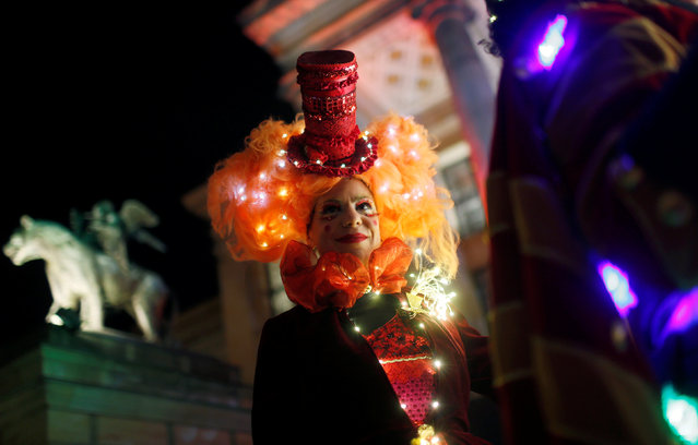 An artist dressed as Puppet Queen poses at the opening of the Christmas market at Gendarmenmarkt square in Berlin, Germany November 21, 2016. (Photo by Hannibal Hanschke/Reuters)