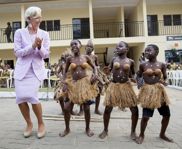 International Monetary Fund (IMF) Managing Director Christine Lagarde dances with some of the orphan children from the La Main Dans La Main charity in Douala, Cameroon January 9, 2016. (Photo by Stephen Jaffe/Reuters/IMF)