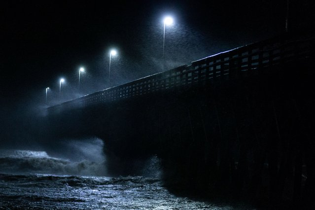 Waves crash into the Second Avenue Pier as Hurricane Florence makes landfall late on September 14, 2018 in Myrtle Beach, S.C. (Photo by Alex Edelman/AFP Photo