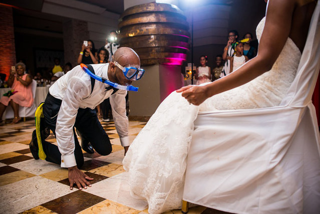 Man wears snorkel at wedding party. (Photo by Tom Harmon/Caters News Agency/ISPWP)
