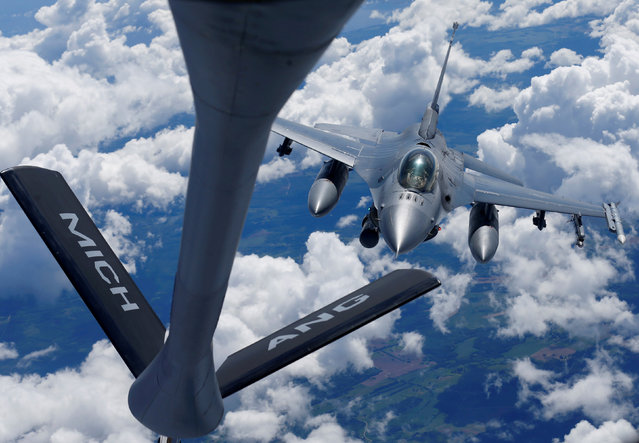 A U.S. Air Force F-16 fighter approaches a KC-135 aerial refueling aircraft during the U.S. led Saber Strike exercise in the air over Estonia June 6, 2018. (Photo by Ints Kalnins/Reuters)