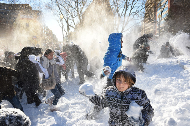Linden Tarrant, 9, takes part in a large snowball fight in Dupont Circle on Sunday January 24, 2016 in Washington, DC. The Washington, DC area was blanketed by a large snow event. (Photo by Matt McClain/The Washington Post)