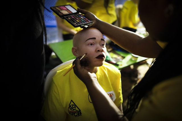 An albino woman gets her makeup done backstage prior to a fashion show during the Mr. & Miss Albinism East Africa contest in Nairobi, Kenya, 30 November 2018. (Photo by Dai Kurokawa/EPA/EFE)