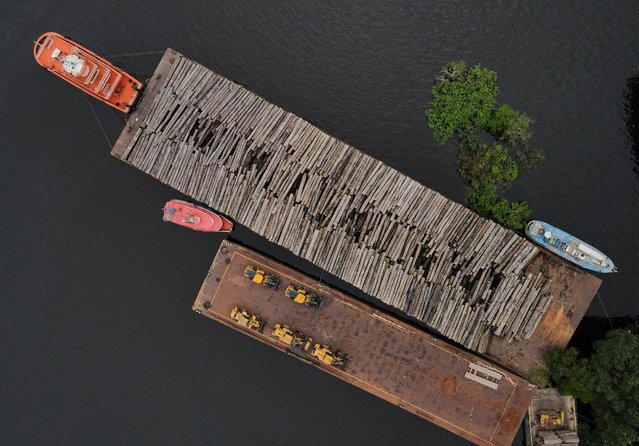 An aerial view show wood logs on a raft at the Federal Police base in Manaus, Amazonas state, Brazil on May 19, 2021. Picture taken with a drone. (Photo by Bruno Kelly/Reuters)