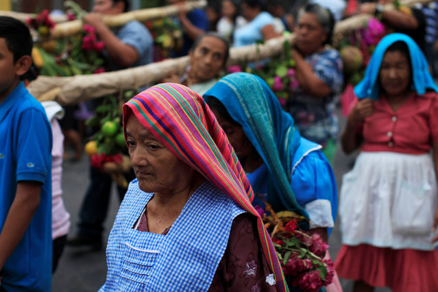 "Catholic faithful participate on a procession during the ""Fiesta de las Palancas"" celebration to ask for blessings and abundance during the new year in Panchimalco, El Salvador, January 5, 2017. (Photo by Jose Cabezas/Reuters)"