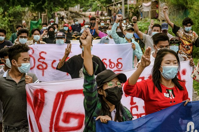 This photo taken and received from an anonymous source via Facebook on June 11, 2021 shows protesters marching during a demonstration against the military coup in Mandalay. (Photo by Handout/Facebook via AFP Photo)