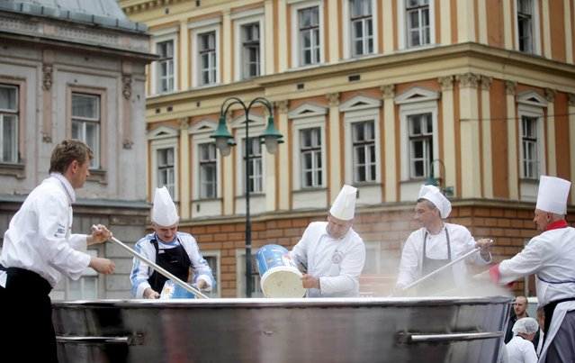 Bosnian chefs cook in a Guinness Book of World Records attempt for the largest chicken broth, in a central square of the Bosnian capital of Sarajevo, April 17, 2015. (Photo by Dado Ruvic/Reuters)