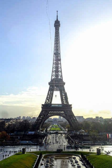 Nathan Paulin of the SDD team, walks an approved highline from the Eiffel Tower to the Trocadero in Paris. the line was 670m long and 70m high. (Photo by Aidan Williams/Caters News Agency)