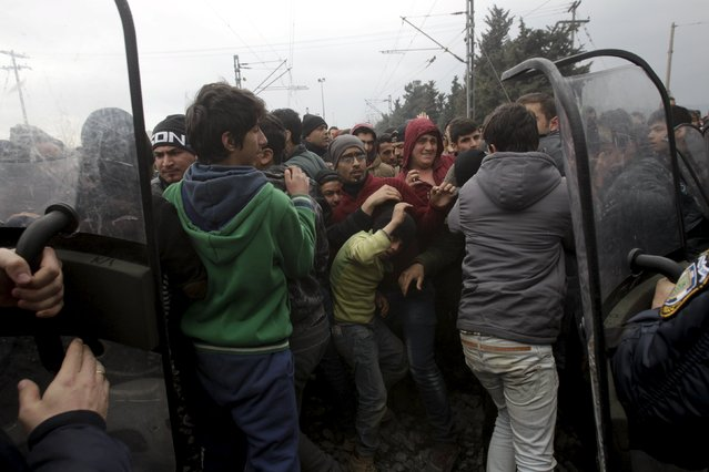 Stranded refugees and migrants are pushed back by Greek riot police after they tried to storm Macedonia from the Greek side of the border during a protest, near the Greek village of Idomeni, February 29, 2016. (Photo by Alexandros Avramidis/Reuters)