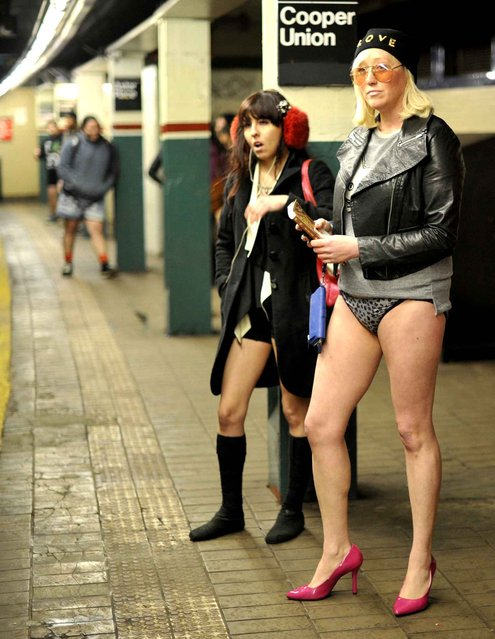 Riders wait for a train in the New York subway in their underwear as they take part in the 2014 No Pants Subway Ride on January 12, 2014. (Photo by Timothy Clary/AFP Photo)