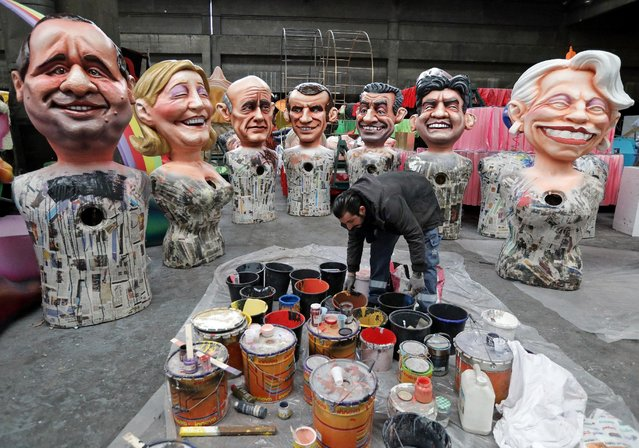 A worker puts the final touches to giant figures of French politicians (L-R) French President Francois Hollande, Marine Le Pen, Alain Juppe, Emmanuel Macron, Nicolas Sarkozy, Jean-Luc Melenchon and Michele Alliot-Marie during preparations for the carnival parade in Nice, France, January 26, 2017. (Photo by Eric Gaillard/Reuters)
