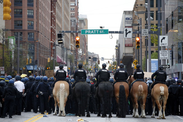 Police attempt to block marchers as they block Pratt Street after a march to City Hall for Freddie Gray, Saturday, April 25, 2015 in Baltimore. (Photo by Alex Brandon/AP Photo)