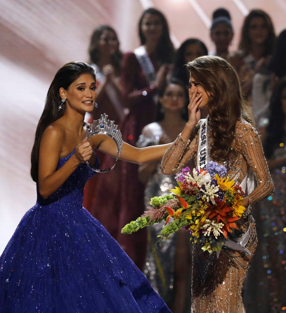Pia Wurtzbach walks towards Miss France Iris Mittenaere after the latter was declared winner in the Miss Universe beauty pageant at the Mall of Asia Arena, in Pasay, Metro Manila, Philippines January 30, 2017. (Photo by Erik De Castro/Reuters)