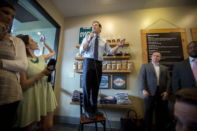 Republican presidential candidate Sen. Marco Rubio, R-Fla., speaks to supporters while standing on a chair at campaign stop at the Maple Street Biscuit Company in Jacksonville, Fla., Monday, March 14, 2016. (Photo by Stephen B. Morton/AP Photo)