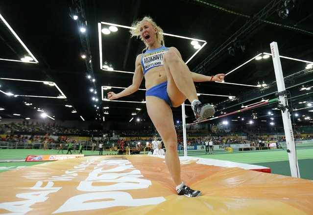 Anastasiya Mokhnyuk of Ukraine celebrates a jump in the high jump portion of the women's pentathlon during the IAAF World Indoor Athletics Championships in Portland, Oregon March 18, 2016. (Photo by Mike Blake/Reuters)