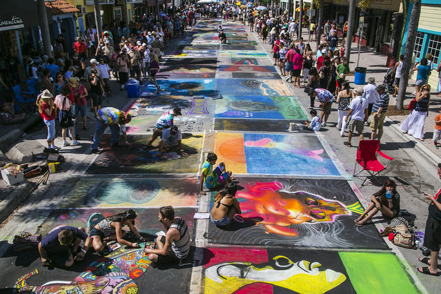 Artists create on Lake Avenue. (Photo by Greg Lovett/The Palm Beach Post)