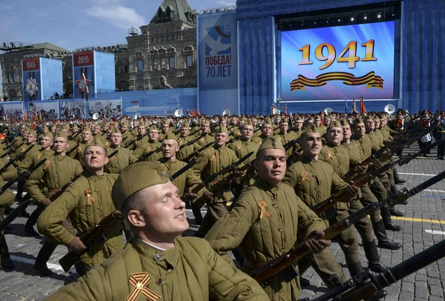 Russian servicemen in historical Red Army uniforms march during the Victory Day parade at Red Square in Moscow, Russia, May 9, 2015. (Photo by Reuters/Host Photo Agency/RIA Novosti)