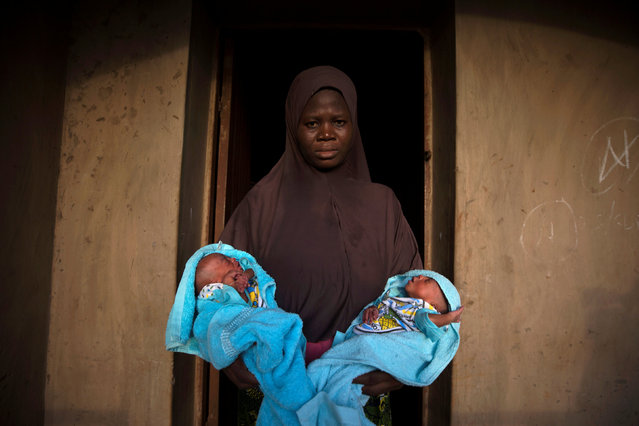 A Muslim woman carries her four-day-old male twins wrapped in blue towels outside the door of her home in Igbo Ora, Oyo State, Nigeria April 3, 2019. (Photo by Afolabi Sotunde/Reuters)
