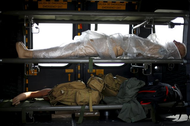 A mannequin is seen inside a helicopter ahead of the International Air and Space Fair (FIDAE) at Santiago international airport, March 28, 2016. (Photo by Ivan Alvarado/Reuters)