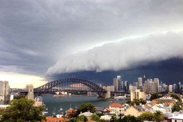 A large storm cloud covers the Sydney CBD on March 5, 2014 in Sydney, Australia. A severe thunderstorm warning was issued for the Sydney metropolitan area late this afternoon with heavy rainfall due to cause flash flooding in areas. (Photo by Cassie Trotter/Getty Images)