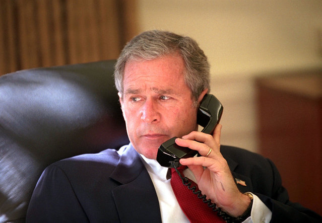 President George W. Bush speaks to Canadian Prime Minister Jean Chretien on the telephone in Washington Sunday, Oct. 7, 2001. Chretien was one of several world leaders Bush spoke to before telling the United States and the world of air strikes against the Taliban. George Walker Bush was the 43rd U.S. President serving from 2001 – 2009. (Photo by Eric Draper/AP Photo/The White House)