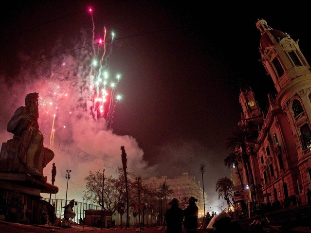 """A statue of Moses """"falla"""" waits the beginning of the """"crema"""", the moment in which more than three hundred """"fallas"""" starts to burn, celebrating Saint Joseph's night during Las Fallas Festival at Town Hall square in Valencia. (Photo by Manuel Bruque/EPA)"""