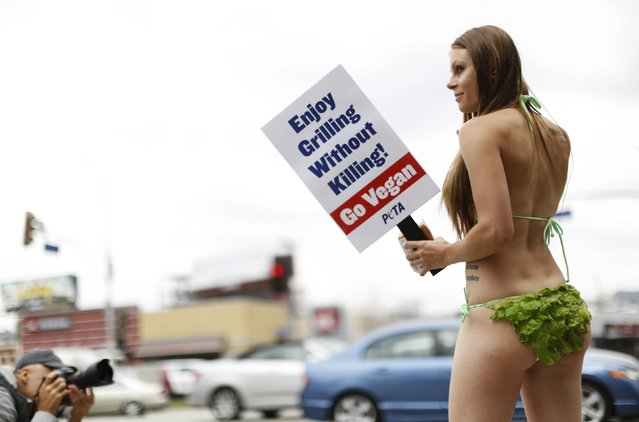 Activist Kimberly Moffatt from People for the Ethical Treatment of Animals (PETA) holds a sign while promoting a vegan diet in Los Angeles, California May 21, 2015. (Photo by Mario Anzuoni/Reuters)