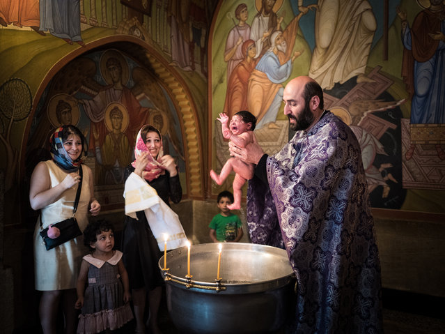 "Culture category, open shortlist. ""Georgian baptism"". An infant is baptised according to the Orthodox rite in a church in Tbilisi, Georgia. (Photo and caption by Beniamino Pisati/2017 Sony World Photography Awards)"