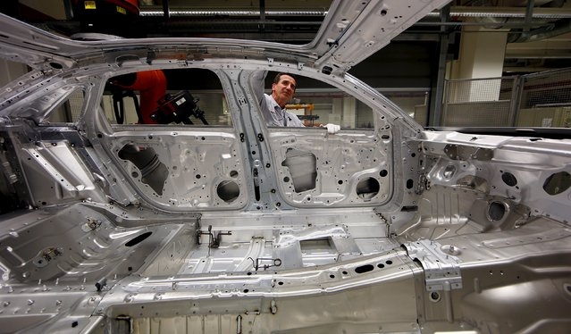 A worker assembles Audi A8 models at their plant in Neckarsulm near Heilbronn May 21, 2015. (Photo by Michael Dalder/Reuters)