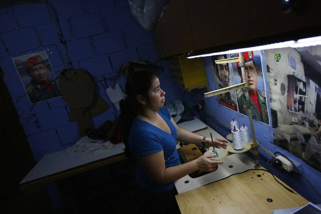 """Maria works in a sewing workshop in her apartment inside the """"Tower of David"""" skyscraper in Caracas. (Photo by Jorge Silva/Reuters)"""