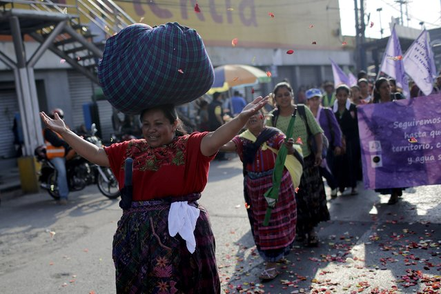 Indigenous people take part in a protest to demand control over water resources in provincial areas, which according to the protesters have become polluted and increasingly scarce, in Guatemala City, Guatemala, April 22, 2016. (Photo by Saul Martinez/Reuters)