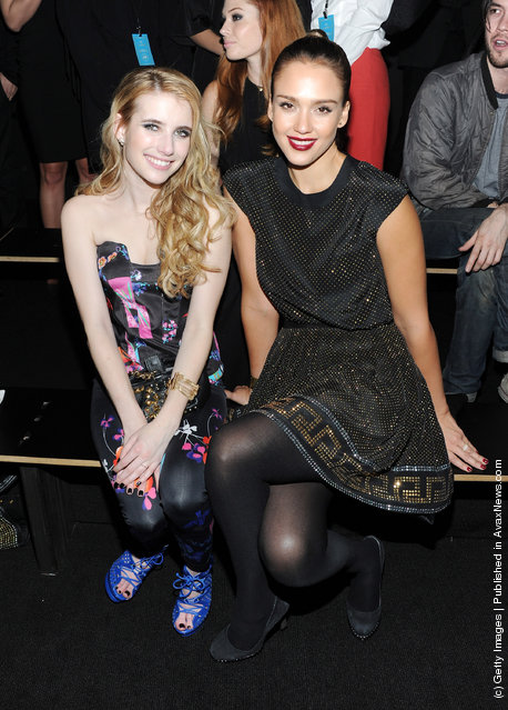 Actresses Emma Roberts and Jessica Alba attend the Versace for H&M Fashion event