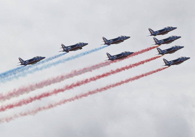 The Alpha Jets of the Patrouille de France acrobatic team perform their demonstration flight during the closing day of the Paris Air Show in Le Bourget, north of Paris, Sunday,  June 21, 2015. Some 300,000 aviation professionals and spectators are expected at this week's Paris Air Show, coming from around the world to make business deals and see dramatic displays of aeronautic prowess and the latest air and space technology. (AP Photo/Michel Euler)