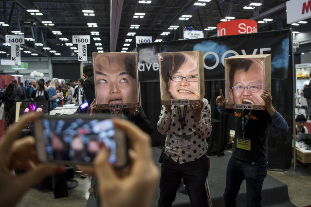 "Attendees wear a cardboard ""Facebox"" at the 2017 South By Southwest (SXSW) Interactive Festival at the Austin Convention Center in Austin, Texas, U.S., on Monday, March 13, 2017. The SXSW Interactive Festival features a variety of tracks that allow attendees to explore what's next in the worlds of entertainment, culture, and technology. (Photo by David Paul Morris/Bloomberg)"