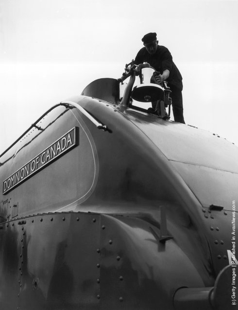 1937: The streamlined class A4 Pacific locomotive 'Dominion of Canada' seen at King's Cross, London, equipped with a locomotive bell of the standard type used in Canada. The bell completes the all-Canadian equipment of the locomotive
