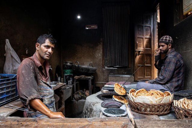 A Kashmiri baker waits for customers during restrictions after the scrapping of the special constitutional status for Kashmir by the government, in Srinagar, August 14, 2019. (Photo by Danish Siddiqui/Reuters)