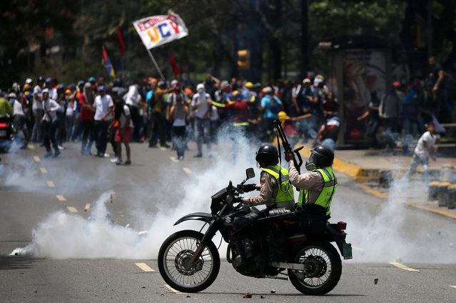 Demonstrators clash with riot police at a rally against Venezuela's President Nicolas Maduro's government in Caracas, Venezuela April 10, 2017. (Photo by Carlos Garcia Rawlins/Reuters)