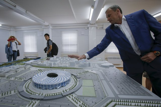 A man shows a model of the new soccer stadium in Nizhny Novgorod, Russia, July 10, 2015. (Photo by Maxim Shemetov/Reuters)