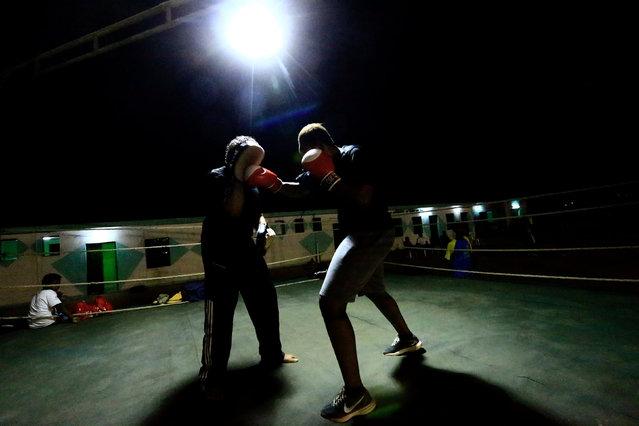 Arafat Abkar (R), 22, practises boxing at the Nile Club in Khartoum May 9, 2016. (Photo by Mohamed Nureldin Abdallah/Reuters)