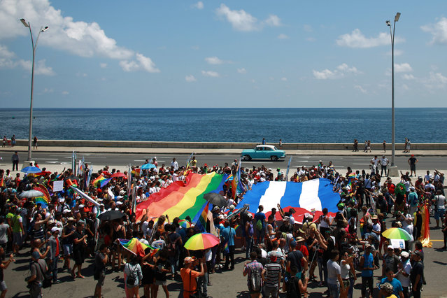 People take part in the Annual March against Homophobia and Transphobia in Havana, May 14, 2016. (Photo by Alexandre Meneghini/Reuters)