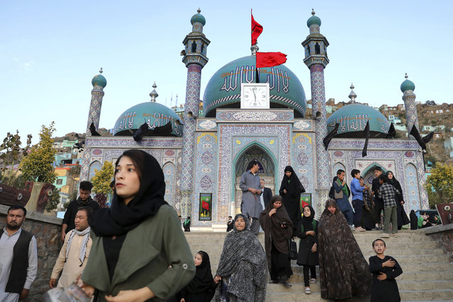 Shiite Muslims visit the Karti Sakhi Shrine a day before Ashoura, in Kabul, Afghanistan, Monday, September 9, 2019. Ashoura falls on the 10th day of Muharram, the first month of the Islamic calendar, when Shiites mark the death of Hussein, the grandson of the Prophet Muhammad, at the Battle of Karbala in present-day Iraq in the 7th century. (Photo by Ebrahim Noroozi/AP Photo)