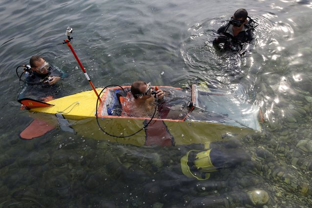 """French adventurer and researcher Stephane Rousson gets ready for the first test of """"Nemo"""", a three-metre long submarine with electric propulsion, on July 15, 2015 in Villefranche-sur-Mer, southeastern France. (Photo by Valery Hache/AFP Photo)"""