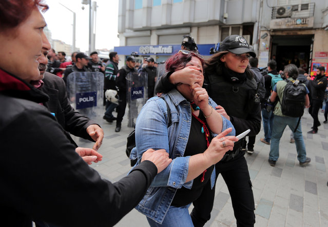 A police officer detains a protester as she and others attempt to defy a ban and to gather at Taksim Square to celebrate May Day, in central Istanbul, Turkey on May 1, 2017. (Photo by Kemal Aslan/Reuters)