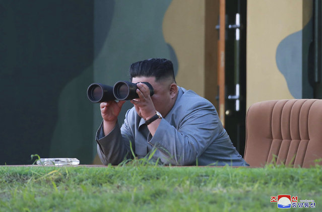 """In this Thursday, July 25, 2019, photo provided on Friday, July 26, 2019, by the North Korean government, North Korean leader Kim Jong Un watches a missile test in North Korea.  A day after two North Korean missile launches rattled Asia, the nation announced Friday that its leader Kim supervised a test of a new-type tactical guided weapon that was meant to be a """"solemn warning"""" about South Korean weapons introduction and its rival's plans to hold military exercises with the United States. Independent journalists were not given access to cover the event depicted in this image distributed by the North Korean government. The content of this image is as provided and cannot be independently verified. Korean language watermark on image as provided by source reads: """"KCNA"""" which is the abbreviation for Korean Central News Agency. (Photo by Korean Central News Agency/Korea News Service via AP Photo)"""