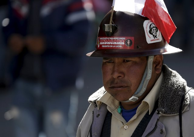 A Potosi mine worker attends a protest march in La Paz, July 20, 2015. Hundreds of demonstrators from Potosi demanded to have a meeting with President Evo Morales to discuss about the industrialization of their region on the eighth day of their protest in La Paz, according to local media. (Photo by David Mercado/Reuters)