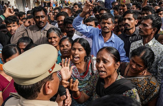 Demonstrators argue with a police officer during a protest against the alleged rape and murder of a 27-year-old woman in Shadnagar, on the outskirts of Hyderabad, November 30, 2019. (Photo by Vinod Babu/Reuters)