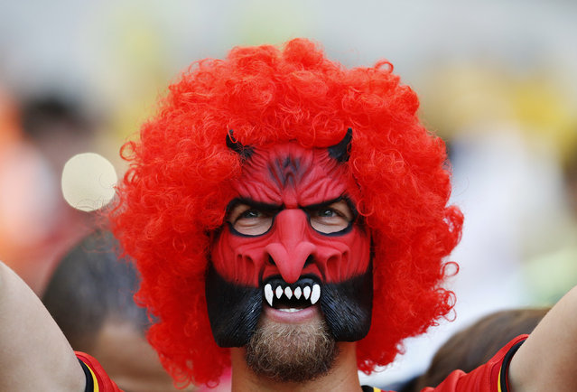 A fan of Belgium wearing a mask, cheers before their 2014 World Cup Group H soccer match against Algeria at the Mineirao stadium in Belo Horizonte June 17, 2014. (Photo by Sergio Perez/Reuters)
