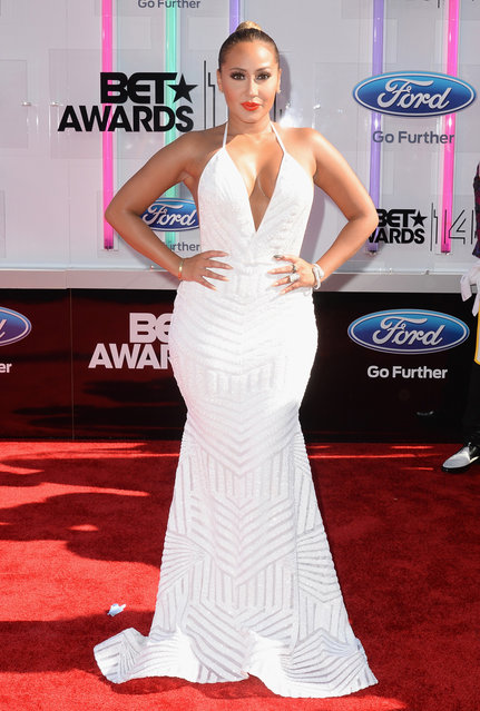 Singer-songwriter Adrienne Bailon attends the BET AWARDS '14 at Nokia Theatre L.A. LIVE on June 29, 2014 in Los Angeles, California. (Photo by Earl Gibson III/Getty Images for BET)